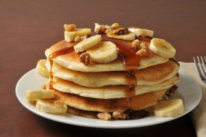 Banana nut pancakes with syrup